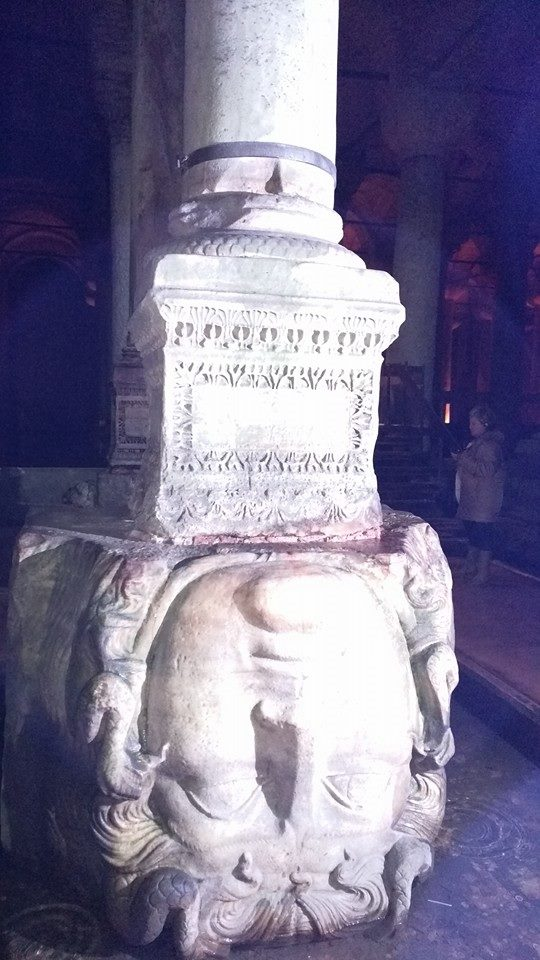 Upside down Medusa head statue inside Basilica Cistern