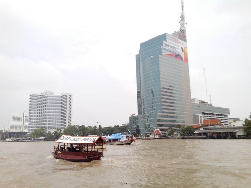 Chao Phraya river - CAT Tower next to the Sheraton Hotel.